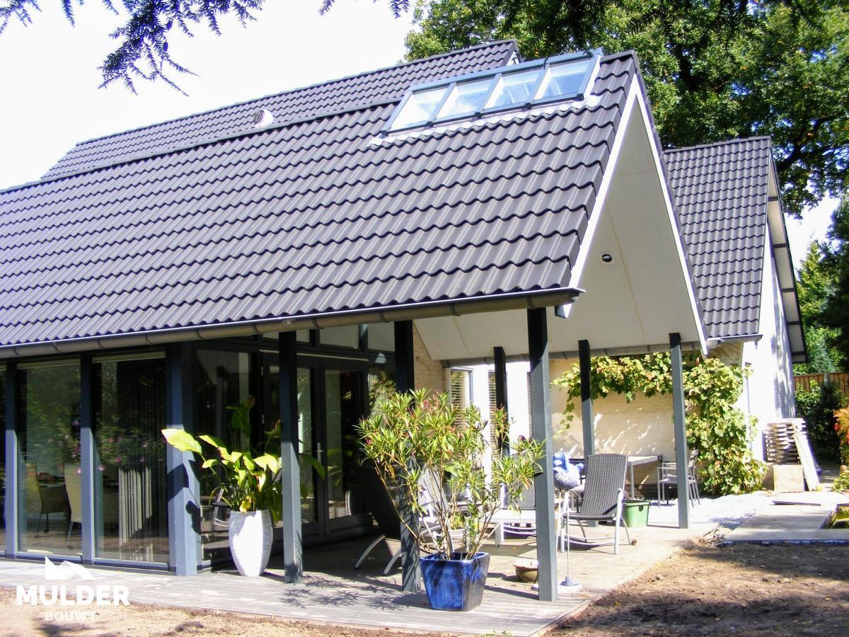 Tuinkamer met puntdak in Enschede